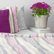 Stock Photo: Bedroom decorated with purple flowers