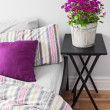 Stock Photo: Purple flowers in bright bedroom