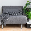 Gray fabric chair and plants in the living room — Stock Photo
