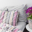 Stock Photo: Bedroom decorated with bright purple flowers