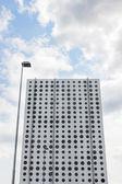 Futuristic building and street lamp — Stock Photo