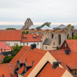 Rooftops and ruins of a medieval church — Stock Photo