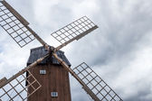 Old windmill under the cloudy sky — Foto Stock