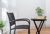 Chair and table with books to read — Stock Photo