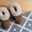 Warm slippers on a rug — Stock Photo