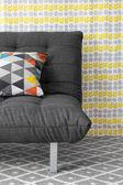 Sofa with colorful cushion — Stockfoto