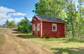 Traditional Swedish cabin painted in red color — Stock Photo