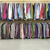 Colorful clothes in a second hand store — Stock Photo