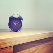 Blue old-fashioned alarm clock — Photo