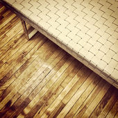 Bench on old wooden floor — Stock Photo