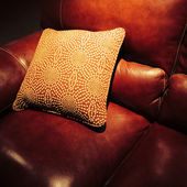Red leather sofa with cushion — Foto Stock