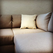Fabric sofa with cushion — Stock Photo