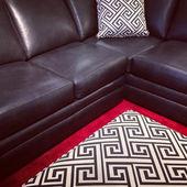 Black leather sofa — Stock Photo