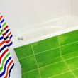 Bright green and white bathroom — Stock Photo