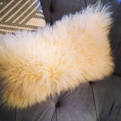 Fluffy cushion on a sofa — Stock Photo