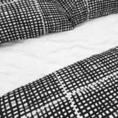 Black and white bed linen with pillows — Stock Photo