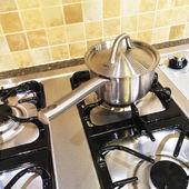 Metal saucepan on gas stove — Stock Photo