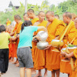 Stock Photo: Merit to monks