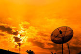 Satellite dish with orange sky — Stock Photo