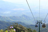 DANANG,VIETNAM - JULY 15: Tourists passenger cable car up the beautiful views on the mountain on July 15,2014 in Danang,vietnam — Stock Photo