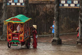 HUE,VIETNAM - JULY 12: Tourist bargain fares to own carriages on July 12,2014 in Hue,Vietnam — Stock Photo