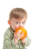 Baby with orange — Stock Photo