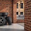 Stock Photo: Tires on garage
