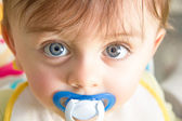 Baby with pacifier — Stock Photo