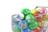 Shopping cart with Easter eggs — Stock Photo