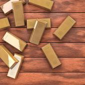 Gold auf holztisch — Stockfoto