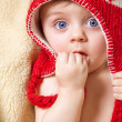Stock Photo: Baby in red bonnet