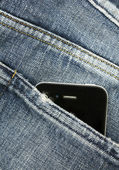 Cell phone in the pocket — Stock Photo