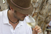 Happy with white wine — Stock Photo