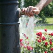 Hand on water tap — Stockfoto