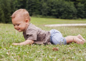 Baby crawling in grass — Stock Photo