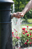 Hand on water tap — Stock Photo
