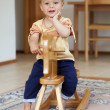 Child on rocking horse — Stock Photo