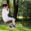 Royalty-Free Stock Photo: Child on rope swing