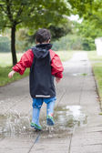Child in puddle — Stock Photo