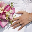 Wedding ring and bouquet — Stock Photo