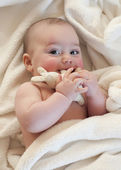 Baby with soft toy — Stock Photo