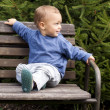 Child on bench - Stock Photo