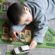 Child playing with toy car — Stock Photo