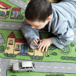 Child playing with toy car — Stock Photo #27246921