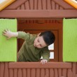 Постер, плакат: Child playing in toy house