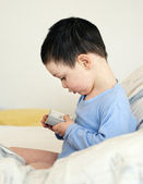 Child with alarm clock — Stock Photo