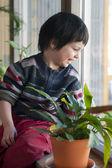 Child at window — Stock Photo