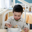 Child at restaurant — Stock Photo #30709919