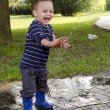 Child at drinking water pipe fountain. — Stock Photo