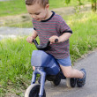 Child on toy bike — Stock Photo